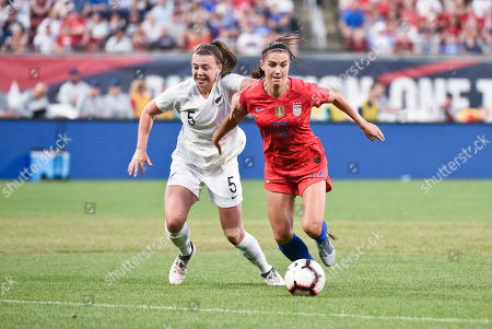 United States forward Alex Morgan (13) works to get past the New Zealand defender Meikayla Moore (5) during the send off series as the United States Women's National Team hosted New Zealand at Busch Stadium in St. Louis City, MO Ulreich/CSM