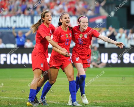 US midfielder, Rose Lavelle (16), US forward, Alex Morgan (13), and US forward, Tobin Heath (17), celebrate after Lavelle (16) scores during the International Women's Soccer match up between the USA and New Zealand, at Busch Stadium in St. Louis, MO. Kevin Langley/Sports South Media/CSM
