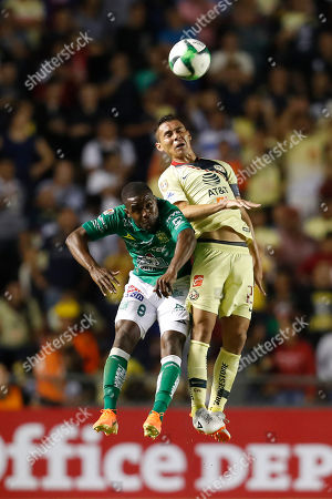 America's Paul Aguilar, right, and Leon's Joel Campbell jumps for the ball during the Mexico Soccer league semi-final first leg match at La Corregidora stadium in Queretaro, Mexico, . Leon won the match 1-0