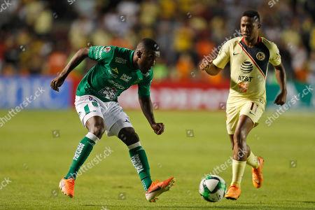 Leon's Joel Campbell, left, kicks the ball past America's Andres Ibarguen during the Mexico Soccer league semi-final first leg match at La Corregidora stadium in Queretaro, Mexico