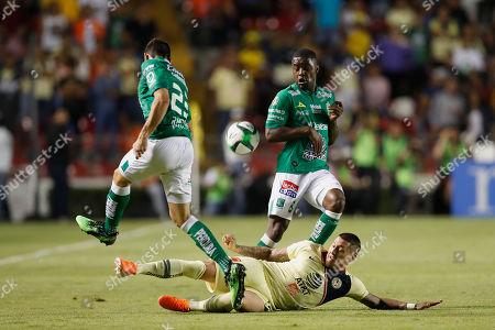 America's Nicolas Castillo, center, fights for the ball against Leon's Ramiro Gonzalez, left, and Joel Campbell, during the Mexico soccer league semi-final first leg match at La Corregidora stadium in Queretaro, Mexico, . Leon won the match 1-0