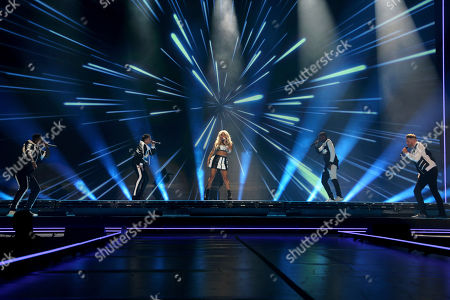 Pentatonix, Scott Hoying, Mitch Grassi, Kirstin Maldonado, Kevin Olusola, Matt Sallee. Kirstin Maldonado, center, of Pentatonix performs live onstage with the band at The Forum, in Inglewood, Calif