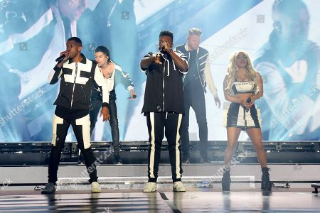 Pentatonix, Scott Hoying, Mitch Grassi, Kirstin Maldonado, Kevin Olusola, Matt Sallee. Pentatonix performs live onstage at The Forum, in Inglewood, Calif