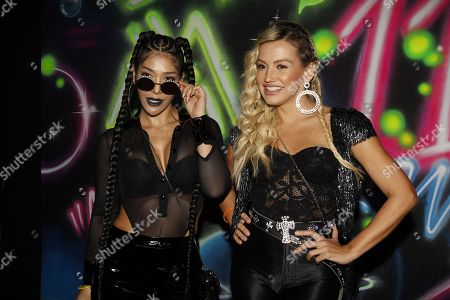 Fanny Lu (R) and Farina (L) pose during launch party of the Colombian singer Maluma's new album '11:11', in Medellin, Colombia, 16 May 2019. 11:11 is the fourth studio album of the Colombian reggaeton singer which includes collaborations with artists such as Ricky Martin, Ozuna, Nicky Jam and Madonna.