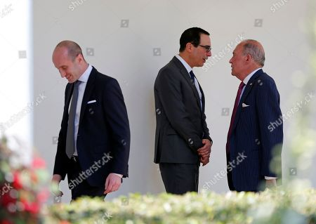 United States Secretary of the Treasury Steven Mnuchin and National Economic Council Director Larry Kudlow chat as Senior Advisor Stephen Miller