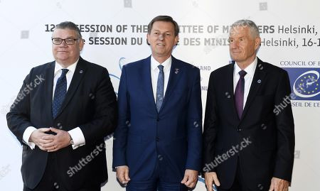 Stock Image of Minister of Foreign Affairs of Finland Timo Soini (L), Minister of Foreign Affairs of Slovenia Miro Cerar and Secretary General of the Council of Europe Thorbjorn Jagland (R)