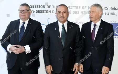 Minister of Foreign Affairs of Finland Timo Soini (L), Minister of Foreign Affairs of Turkey Mevlut Cavusoglu and Secretary General of the Council of Europe Thorbjorn Jagland (R)
