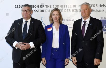 Minister of Foreign Affairs of Finland Timo Soini (L), Consul General of the United States of America in Strasbourg and Deputy Permanent Representative of the United States to the Council of Europe Cara C. MacDonald and Secretary General of the Council of Europe Thorbjorn Jagland (R)