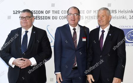 Minister of Foreign Affairs of Finland Timo Soini (L), Deputy Head of Mission of Canada to the European Union Alan Bowman and Secretary General of the Council of Europe Thorbjorn Jagland (R)