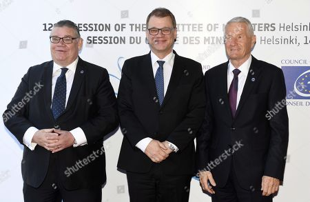 Minister of Foreign Affairs of Finland Timo Soini (L), Prime Minister of Finland Juha Sipila and Secretary General of the Council of Europe Thorbjorn Jagland (R)