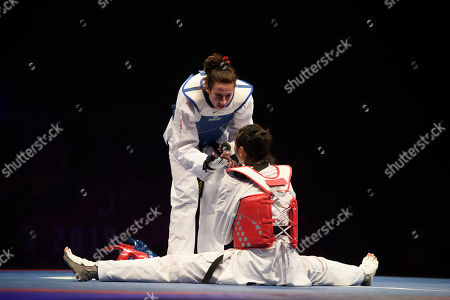 Bianca Walkden of Great Britain celebrates after winning the Womens 73kg Final fight after Shuyin Zheng of China  was disqualified.