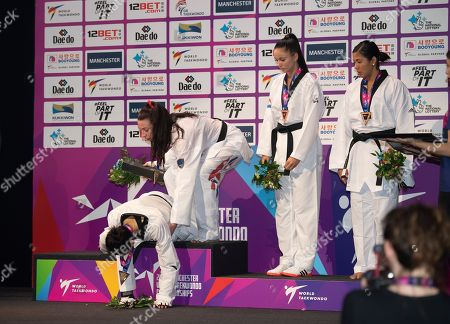 Bianca Walkden of Great Britain receives the winners medal in the Womens 73kg Final fight after beating Shuyin Zheng of China  after she was disqualified and then collapses on the podium.