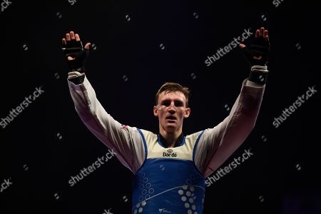 Bradly Sinden of Great Britain celebrates after winning the Mens 68kg Final fight against Javier Perez Polo of Spain.