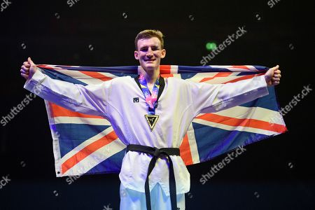 Bradly Sinden of Great Britain poses with the winners medal after winning the Mens 68kg Final fight against Javier Perez Polo of Spain.