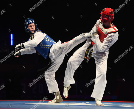 Bradly Sinden of Great Britain and Javier Perez Polo of Spain during the Mens 68kg Final fight.