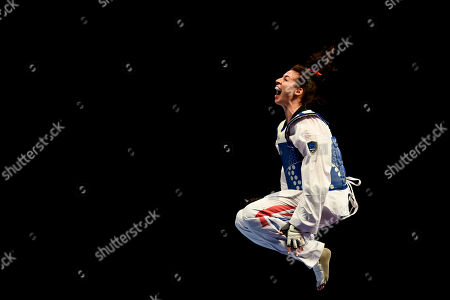 Stock Image of Bianca Walkden of Great Britain celebrates after winning the Womens 73kg Final fight after Shuyin Zheng of China  was disqualified.