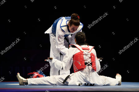 Bianca Walkden of Great Britain talks Shuyin Zheng of China to after winning the Womens 73kg Final fight.
