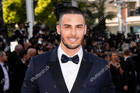 Baptiste Giabiconi poses for photographers upon arrival at the premiere of the film 'Rocketman' at the 72nd international film festival, Cannes, southern France