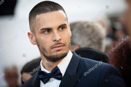 Stock Picture of Baptiste Giabiconi poses for photographers upon arrival at the premiere of the film 'Rocketman' at the 72nd international film festival, Cannes, southern France