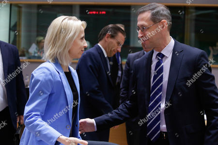 Poland's Finance Minister Teresa Czerwinska (L) with Hungarian Finance Minister, Mihaly Varga (R), at the start of an Economic and Financial affairs meeting council (ECOFIN), at the European Council in Brussels, Belgium, 17 May 2019. The ministers will hold a debate on digital taxation and talk main outcomes of the G20, IMF and World Bank spring meetings as well as adopt conclusions based on the European Semester exercise for 2019.