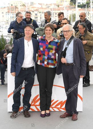 Stock Picture of Paul Laverty, Rebecca O'Brien, Ken Loach. Writer Paul Laverty, from left, Rebecca O'Brien and director Ken Loach pose for photographers at the photo call for the film 'Sorry We Missed You' at the 72nd international film festival, Cannes, southern France
