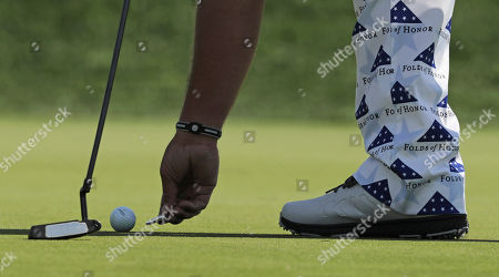 John Daly marks his ball on the 11th green during the second round of the PGA Championship golf tournament, at Bethpage Black in Farmingdale, N.Y
