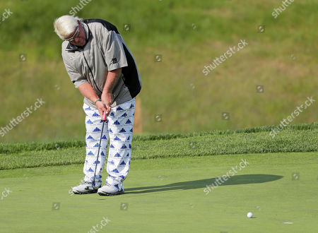 John Daly misses a putt on the fifth green during the second round of the PGA Championship golf tournament, at Bethpage Black in Farmingdale, N.Y