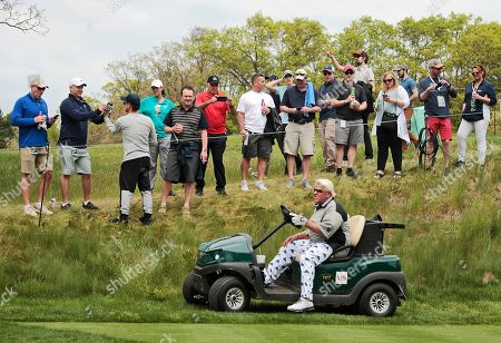 John Daly drives his cart off the 16th tee during the second round of the PGA Championship golf tournament, at Bethpage Black in Farmingdale, N.Y