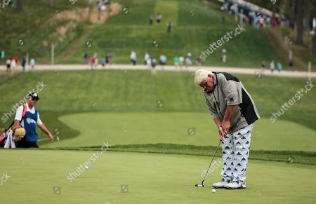 John Daly putts on the 18th green during the second round of the PGA Championship golf tournament, at Bethpage Black in Farmingdale, N.Y