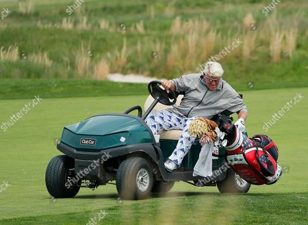 John Daly picks up his bag to pull his putter on the 18th hole during the second round of the PGA Championship golf tournament, at Bethpage Black in Farmingdale, N.Y