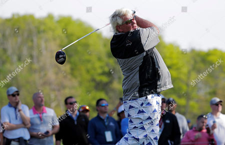 John Daly drives off the sixth tee during the second round of the PGA Championship golf tournament, at Bethpage Black in Farmingdale, N.Y