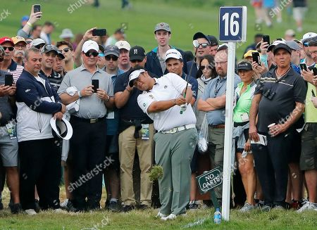 Kiradech Aphibarnrat of Thailand hits out of the gallery on the 16th hole during the second round of the PGA Championship golf tournament, at Bethpage Black in Farmingdale, N.Y