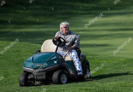 John Daly gets in his golf cart after putting on the fifth green during the second round of the PGA Championship golf tournament, at Bethpage Black in Farmingdale, N.Y