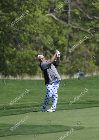 John Daly of the US hits from the fairway on the eleventh hole during the second round of the 2019 PGA Championship at Bethpage Black in Farmingdale, New York, USA, 17 May 2019. The Championship runs from 16-19 May.