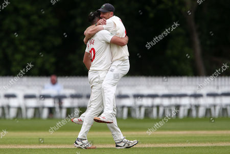 Marchant De Lange celebrates with Graham Wagg after Miles Hammond is caught by Tom Cullen.