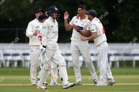 Marchant De Lange of Glamorgan celebrates with team mates after Miles Hammond is caught by Tom Cullen.