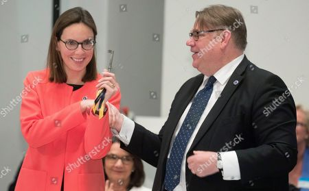 Timo Soini (R) Foreing Minister of Finland gives the key to Amelie de Montchalin (L) Frances Secretary of State for European affair during the Ministers for Foreing Affairs of the Council of Europe's annual meeting at Finlandia House in Helsinki, Finland, 17 May 2019.