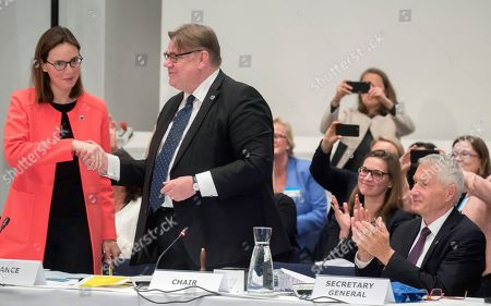 Stock Image of Timo Soini (2-L) Foreing Minister of Finland gives the key to Amelie de Montchalin (L) Frances Secretary of State for European affair during the Ministers for Foreing Affairs of the Council of Europe's annual meeting at Finlandia House in Helsinki, Finland, 17 May 2019.