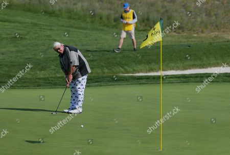 John Daly putts on the sixth green during the second round of the PGA Championship golf tournament, at Bethpage Black in Farmingdale, N.Y