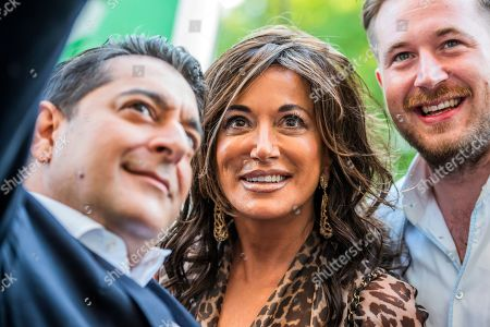 Nancy Dell'Olio with guests at the launch party for Opera Gallery's 'Spaziale!' exhibition at the Italian Embassy.