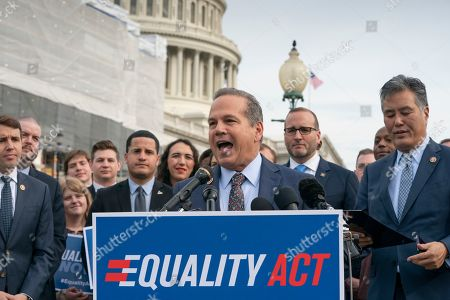 """David Cicilline, Mark Takano, Chad Griffin. Rep. David Cicilline, D-R.I., joined at right by Chad Griffin, president of the Human Rights Campaign, and Rep. Mark Takano, D-Calif., speaks before a House vote on the """"Equality Act of 2019,"""" which would modify existing civil rights law to extend anti-discrimination protections to LGBT Americans in access to employment, education, credit, jury service, federal funding, housing and public accommodations, at the Capitol in Washington, . Cicilline is the chief sponsor of the bill to protect LGBTQ rights"""