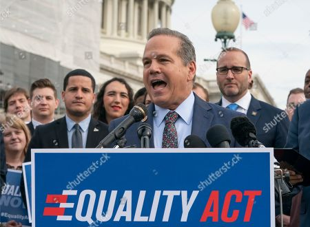 """David Cicilline, Chad Griffin. Rep. David Cicilline, D-R.I., joined at right by Chad Griffin, president of the Human Rights Campaign, speaks before a House vote on the """"Equality Act of 2019,"""" which would modify existing civil rights law to extend anti-discrimination protections to LGBT Americans in access to employment, education, credit, jury service, federal funding, housing and public accommodations, at the Capitol in Washington, . Cicilline is the chief sponsor of the bill to protect LGBTQ rights"""