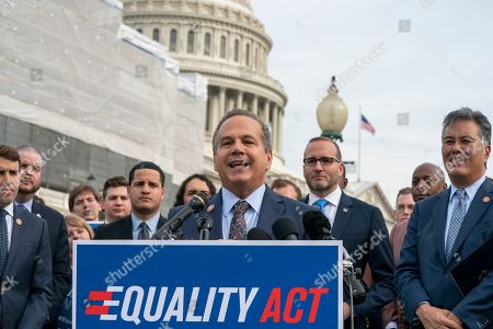 """David Cicilline, Mark Takano, Chad Griffin. Rep. David Cicilline, D-R.I., joined at right by Chad Griffin, president of the Human Rights Campaign, and Rep. Mark Takano, D-Calif., rally before a House vote on the """"Equality Act of 2019,"""" which would modify existing civil rights law to extend anti-discrimination protections to LGBT Americans in access to employment, education, credit, jury service, federal funding, housing and public accommodations, at the Capitol in Washington, . Cicilline is the chief sponsor of the bill to protect LGBTQ rights"""