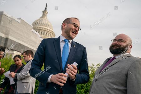 """Masen Davis, Chad Griffin. Chad Griffin, president of the Human Rights Campaign, left, talks with Masen Davis, right, a transgender rights activist, as advocates for LGBTQ rights rally before a vote in the House on the """"Equality Act of 2019,"""" sweeping anti-discrimination legislation that would extend civil rights protections to LGBT people by prohibiting discrimination based on sexual orientation or gender identity, at the Capitol in Washington"""