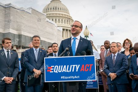 """David Cicilline, Mark Takano, Chad Griffin. Chad Griffin, president of the Human Rights Campaign, flanked by Rep. Mark Takano, D-Calif., left, and Rep. David Cicilline, D-R.I., speaks to advocates for LGBTQ rights as they rally before a vote in the House on the """"Equality Act of 2019,"""" sweeping anti-discrimination legislation that would extend civil rights protections to LGBT people by prohibiting discrimination based on sexual orientation or gender identity, at the Capitol in Washington, . Cicilline is the chief sponsor of the bill to protect LGBTQ rights"""
