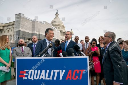 """Mark Takano, Chad Griffin. Rep. Mark Takano, D-Calif., left, is greeted by Chad Griffin, president of the Human Rights Campaign, as they and other advocates for LGBTQ rights rally before a vote in the House on the """"Equality Act of 2019,"""" sweeping anti-discrimination legislation that would extend civil rights protections to LGBT people by prohibiting discrimination based on sexual orientation or gender identity, at the Capitol in Washington"""