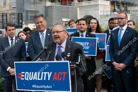 """Diego Sanchez, Mark Takano, Chad Griffin. Transgender rights activist Diego Sanchez, joined at left by Rep. Mark Takano, D-Calif., and Chad Griffin, president of the Human Rights Campaign, far right, speaks to advocates for LGBTQ rights as they rally before a vote in the House on the """"Equality Act of 2019,"""" sweeping anti-discrimination legislation that would extend civil rights protections to LGBT people by prohibiting discrimination based on sexual orientation or gender identity, at the Capitol in Washington"""
