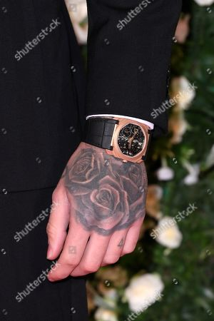 Liam Payne, watch and tattoo detail