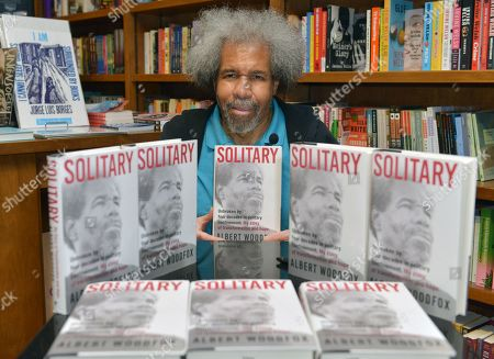 """Former """"Angola 3"""" inmate Albert Woodfox poses for portrait after signing copies of his book """"Solitary"""" at Books & Books"""