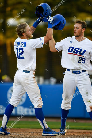 Georgia State's Luke Leonard (12) celebrates with Brandon Bell as he crosses home plate after hitting a two-run home run against Georgia Southern during an NCAA college baseball game, in Decatur, Ga
